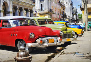 detail of colorful group of vintage american cars parked in a street of old havana_315_215